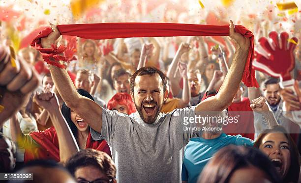 sport fans: a man with scarf - cheering stock pictures, royalty-free photos & images