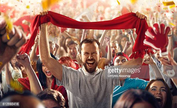 sport fans: a man with scarf - football fan stock photos and pictures