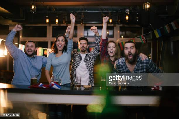 Sport fans at the bar celebrating