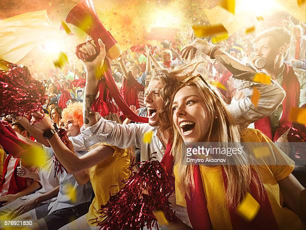 sport fans: group of cheering fans - supporter stock pictures, royalty-free photos & images