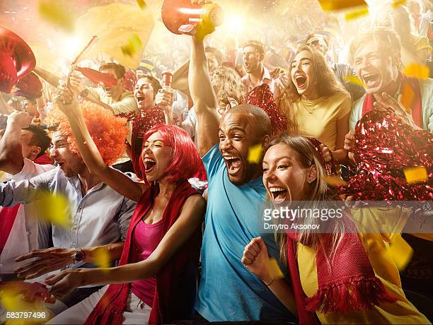 sport fans: group of cheering fans - vreugde stockfoto's en -beelden