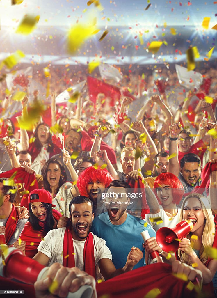Sport fans: Happy cheering crowd : Stock Photo