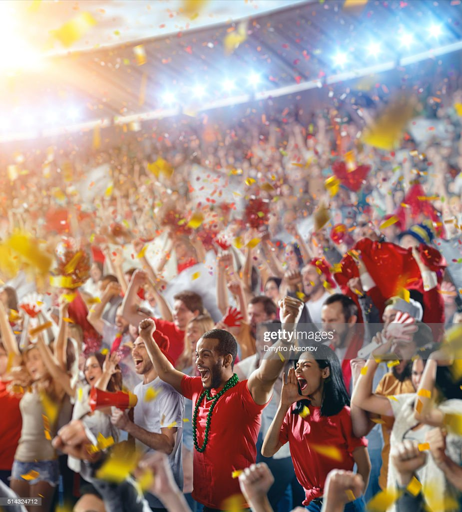 Sport fans: Happy cheering crowd : Stock Photo