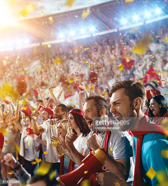 sport fans: happy cheering crowd - match sport stock pictures, royalty-free photos & images