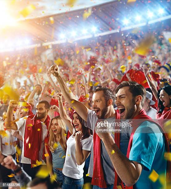 Sport fans: Happy cheering friends