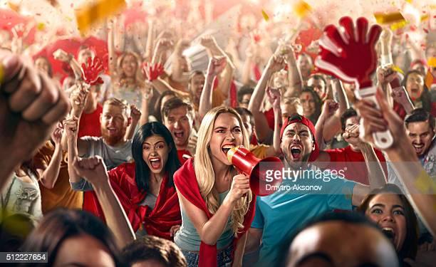 Sport fans: Shouting in megaphone