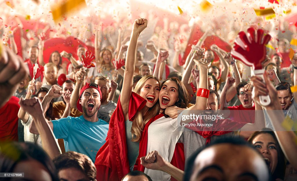 Sport fans: Two girls embrace each other : Stock Photo