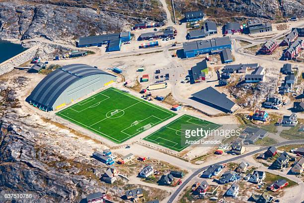 sport fields and residential district in nuuk greenland from above - capital cities stock photos and pictures