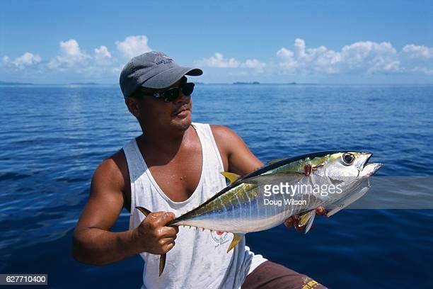 Sport Fisherman Holding Yellowfin Tuna
