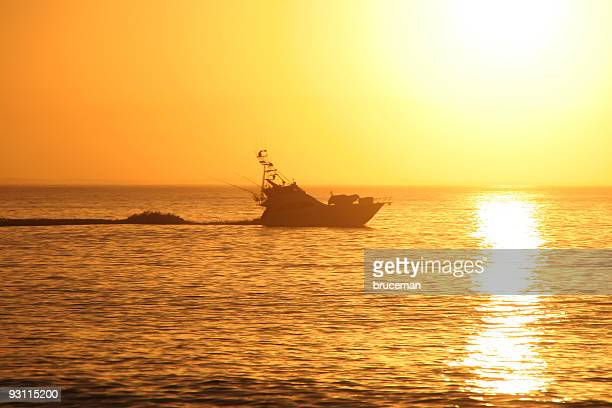 sport fishing boat at sunrise - big game fishing stock photos and pictures