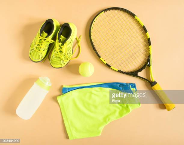 sport, fitness, tennis, healthy lifestyle, sport stuff. tennis racquet, lime trainers, tennis... - ラケット ストックフォトと画像