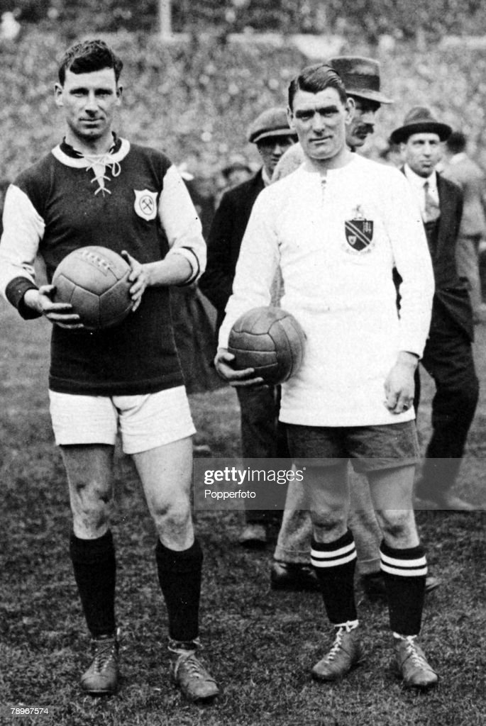 Sport. Football. 1923 FA Cup Final. Wembley Stadium. 28th April, 1923. Bolton Wanderers 2 v West Ham United 0. Rival captains George Kay (left) of West Ham and Joe Smith pose for an historic photograph before the first ever Wembley Cup Final. : News Photo