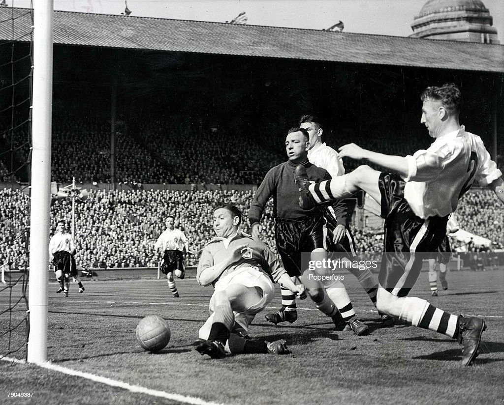 Sport. Football. 1953 FA Cup Final. Wembley Stadium. 2nd May, 1953. Blackpool 4 v Bolton Wanderers. Blackpool's Stan Mortensen falls to the ground as he scores his side's second goal on his way to completing a hat-trick. : News Photo