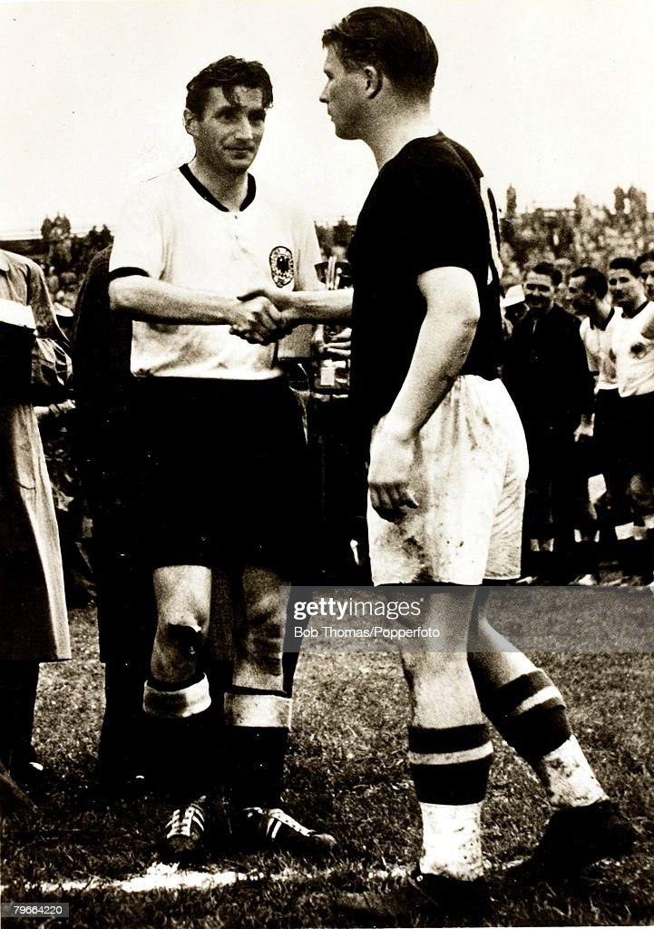 Sport, Football, 1954 World Cup Final, Berne, West Germany,3,v Hungary,2, West Germany captain, Fritz Walter, (facing in white shirt), shakes hands with beaten rival Hungary's Ferenc Puskas : News Photo