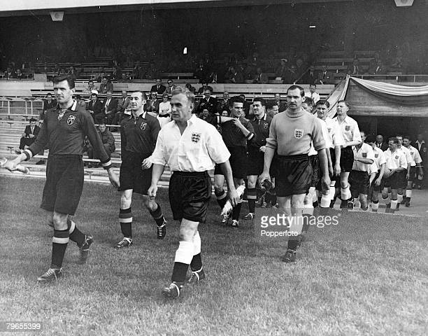 Sport Football 1954 World Cup Finals Basle Switzerland pic 17th June 1954 England 4 v Belgium 4 England captain Billy Wright leads out the England...