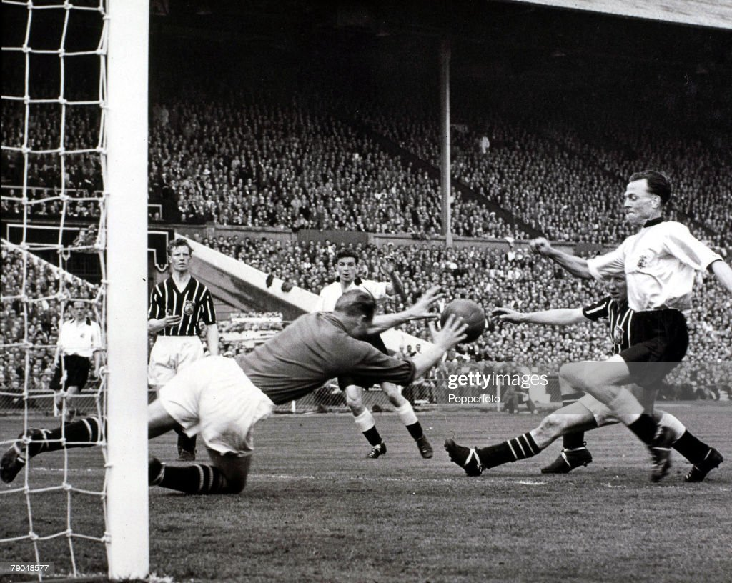 Sport, Football, 1956 FA Cup Final, Wembley, 5th May, 1956, Manchester City 3 v Birmingham 1, Manchester City's goalkeeper Bert Trautmann (the first German to play in a Wembley Cup Final) saves bravely from the advancing Birmingham striker Peter Murphy in the 75th minute, In the collision that followed Trautmann sustained a broken neck, However, he played on and the injury was not diagnosed until several days later after x-rays at the Manchester Royal Infirmary