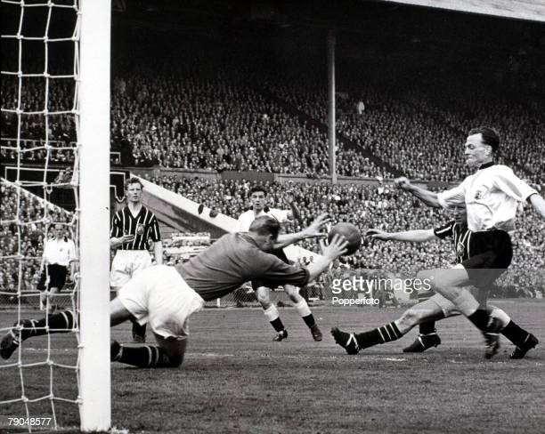 Sport Football 1956 FA Cup Final Wembley 5th May Manchester City 3 v Birmingham 1 Manchester City's goalkeeper Bert Trautmann saves bravely from the...