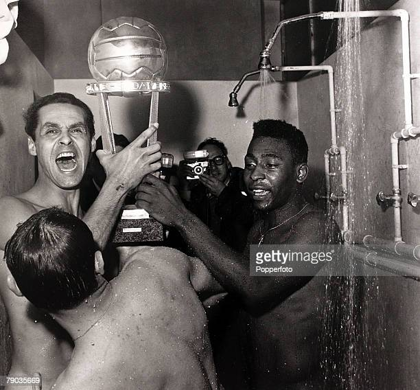 Sport Football 1962 Intercontinental Championship Santos players Gilmar and Pele hold the trophy while in the showers after beating AC Milan 10 in a...