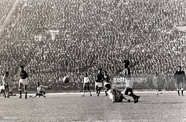 Sport Football 1962 World Cup Finals Santiago Chile SemiFinal 13th June 1962 Brazil 4 v Chile 2 Brazil's Garrincha is stopped by the Chilean defence...