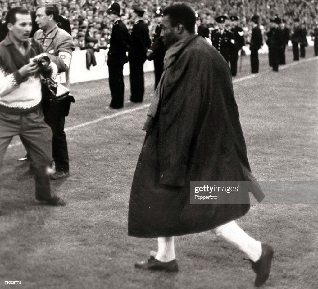 Sport. Football. 1966 World Cup Finals. Goodison Park, Liverpool, England. 19th July 1966. Group 3. Brazil 1 v Portugal 3. Brazil star Pele leaves the field with a raincoat slung over his shoulders, after being injured and forced from the game by some cru : News Photo
