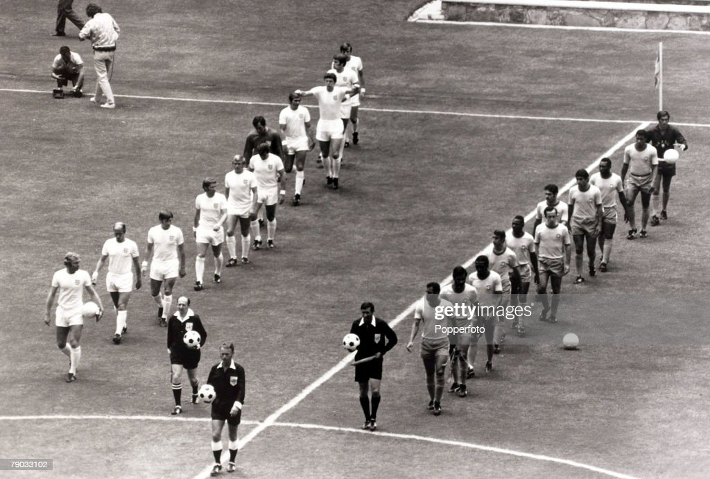 Sport. Football. 1970 World Cup Finals. Guadalajara, Mexico. 7th June 1970. Group 3. England 0 v Brazil 1. The two teams walk onto the pitch together, England led by captain Bobby Moore and Brazil by their skipper Carlos Alberto. : News Photo
