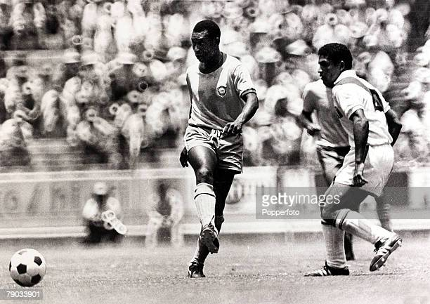 Sport Football 1970 World Cup Finals Guadalajara Mexico Quarter Final 14th June 1970 Brazil 4 v Peru 2 Brazil's Pele plays the ball as a defender...