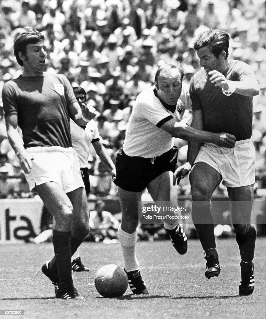 Sport Football. 1970 World Cup Finals. Leon, Mexico. pic: 14th June 1970. Quarter Final. West Germany 3 v England 2 (after extra time). West Germany's Uwe Seeler is challenged by England pair Martin Peters, left and Alan Mullery, right in a battle for th : News Photo