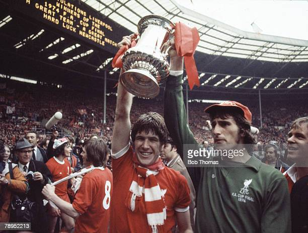 Sport Football 1974 FA Cup Final Wembley London England Liverpool 3 v Newcastle United 0 Liverpool's Emlyn Hughes and goalkeeper Ray Clemence parade...