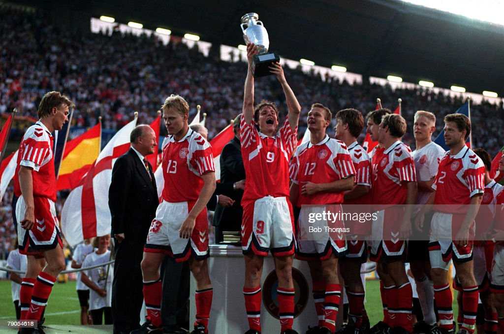 Sport, Football. 1992 European Championships Final. Gothenburg, Sweden. Denmark 2 v Germany 0. 26th June, 1992. Flemming Poulsen holds the trophy aloft after the presentation. : News Photo