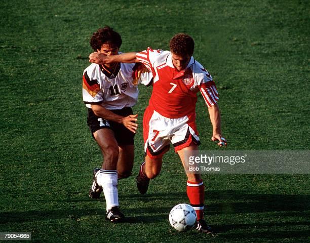 Sport Football 1992 European Championships Final Gothenburg Sweden Denmark 2 v Germany 0 26th June Denmark's John Jensen is tackled by Germany's...