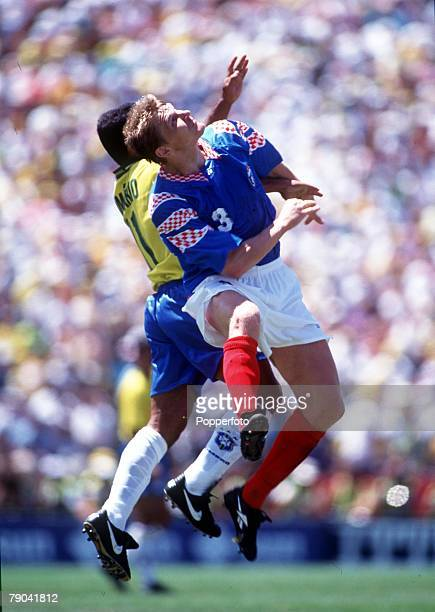 Sport Football 1994 World Cup Finals Stanford USA 20th June Brazil 2 v Russia 0 Russia's S Gorlukovich beats Brazil's Romario in the air