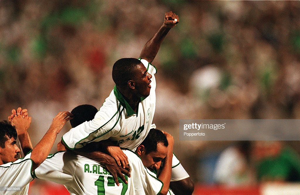 Sport. Football. 2002 World Cup Qualifier. AFC, Second Round, Group A. Jeddah. 28th September 2001. Saudi Arabia 2 v Iran 2. Saudi Arabia's Ahmed Dukhi Al Dossary (12) celebrates with team-mates. : News Photo