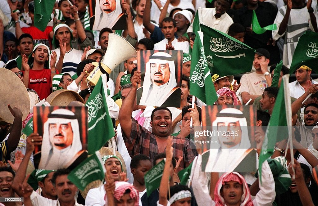 Sport. Football. 2002 World Cup Qualifier. AFC, Second Round, Group A. Jeddah. 28th September 2001. Saudi Arabia 2 v Iran 2. Saudi Arabia fans wave flags and posters. : News Photo