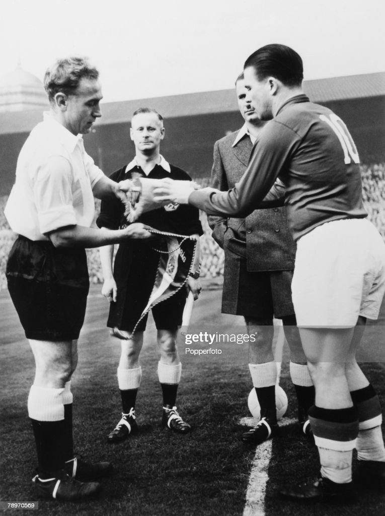 Sport. Football 25th November 1953. England 3 v Hungary 6. The two captains Ferenc Puskas of Hungary and Billy Wright (left) of England exchange penants before the start of the match. : News Photo