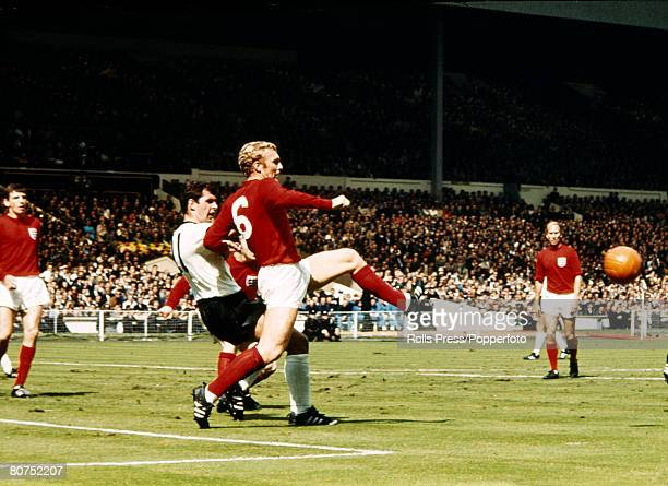Sport Football 30th July 1966 1966 World Cup Final at Wembley England 4 v West Germany 2 aet England captain Bobby Moore clears the ball from West...