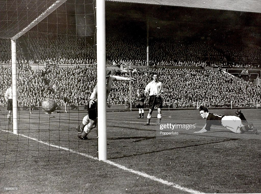 Sport. Football. 9th April 1949. Wembley, London, England. England 1 v Scotland 3. Scotland+s third goal is scored by Lawrie Reilly. The beaten England goalkeeper is Frank Swift. : News Photo