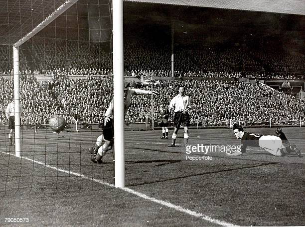 Sport Football 9th April 1949 Wembley London England England 1 v Scotland 3 Scotlands third goal is scored by Lawrie Reilly The beaten England...