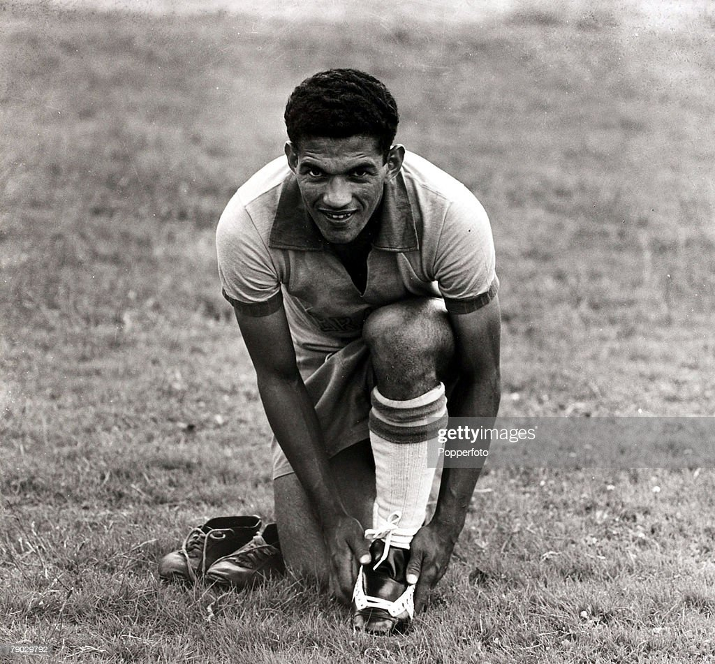 Sport. Football. April 1957. Brazil international Garrincha putting on his boots. He went on to become a double World Cup winner in 1958 and 1962 with Brazil. : News Photo