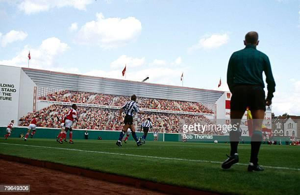 "Sport, Football, Arsenal F,C, pic: August 1992, Premier League, Arsenal v Sheffield Wednesday, Arsenal's Highbury Stadium the ""mural"" behind the goal"