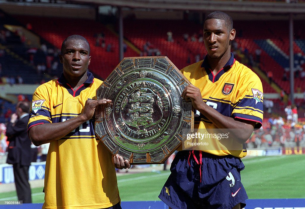 Sport, Football, AXA FA Charity Shield, Wembley, London, England, 9th August 1998, Arsenal 3 v Manchester United 0, Arsenal's Christopher Wreh (left) and Nicolas Anelka, the scorers of their sides' second and third goals, celebrate with the trophy