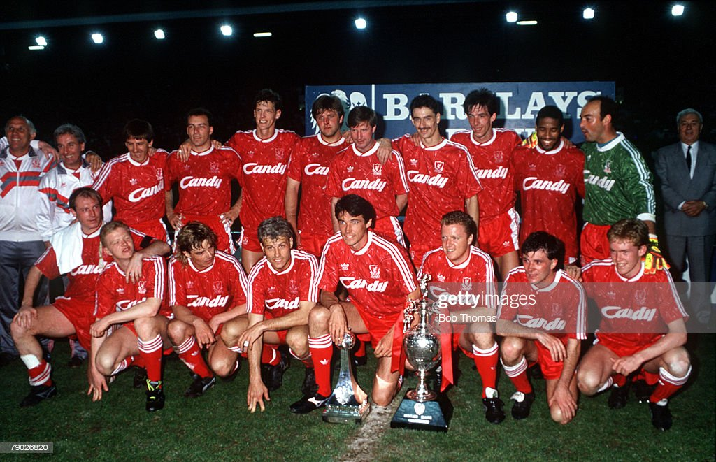 Sport. Football. Barclays League Division One. Anfield, England. 1st May 1990. Liverpool 1 v Derby County 0. The Liverpool team celebrate with the trophies after winning the League Championship for the season 1989-90. Back Row L-R: Ronnie Moran, Roy Evans : News Photo