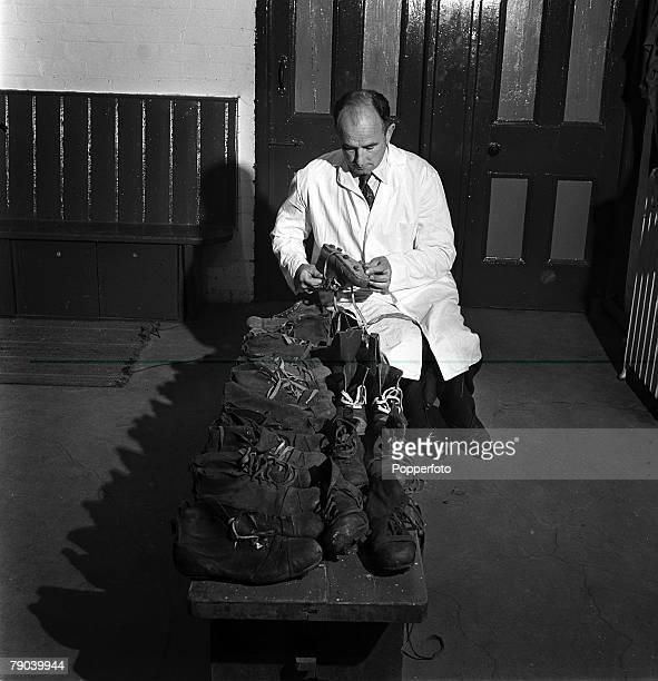 Sport Football Bolton Wanderers' trainer Bill Ridding inspecting player's football boots