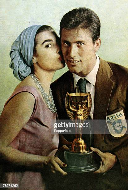 Sport Football Brazil captain Bellini receives a kiss from Miss Brazil Adalgisa Colombo as he holds the Jules Rimet World Cup trophy Brazil had...