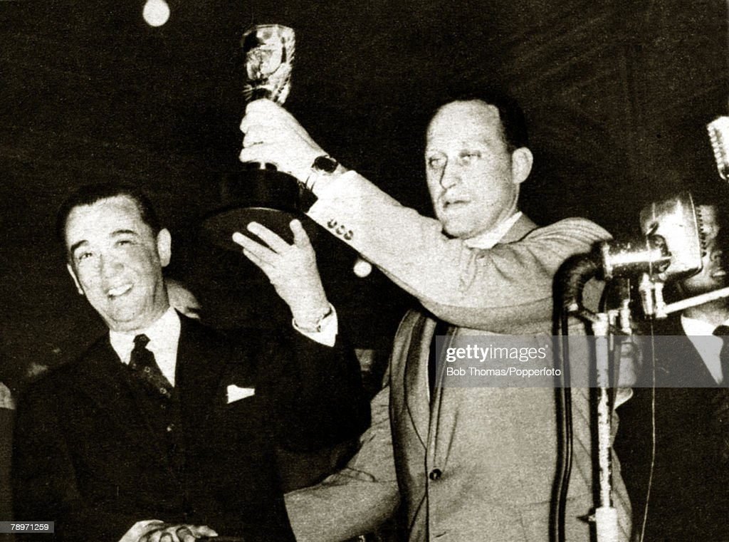 Sport, Football, 1958, Brazil's Joao Havelange hoists the Jules Rimet trophy assisted by the country's President Juscelino Kubitschek after the Brazilian team had been victorious in Sweden and become world champions by beating the host nation 5-2 in the 1958 World Cup Final