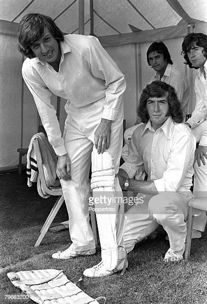 Sport Football Broxbourne Hertfordshire England 12th August 1973 Tottenham Hotspur and England player Martin Peters gets help to 'pad up' from Spurs...