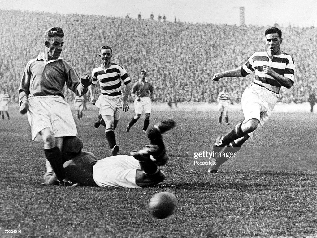 Sport. Football. Celtic Park, Glasgow, Scotland. September 1931. Celtic v Rangers. Celtic goalkeeper Johnny Thomson dives at the feet of Rangers' Sam English in an attempt to stop a goal and in the collision Thomson suffered a fractured skull and died lat : News Photo