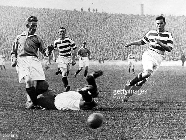 Sport Football Celtic Park Glasgow Scotland September 1931 Celtic v Rangers Celtic goalkeeper Johnny Thomson dives at the feet of Rangers' Sam...
