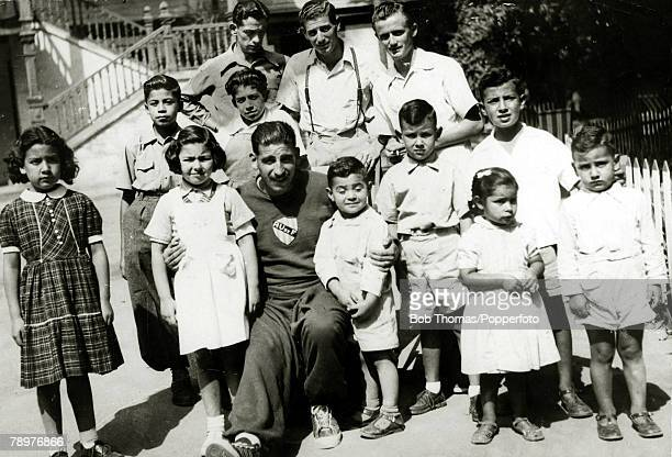 Sport Football circa 1950 Uruguayan football hero Alcides Edgardo Ghiggia poses for the camera with a group of fans in Montevideo Alcides Edgardo...