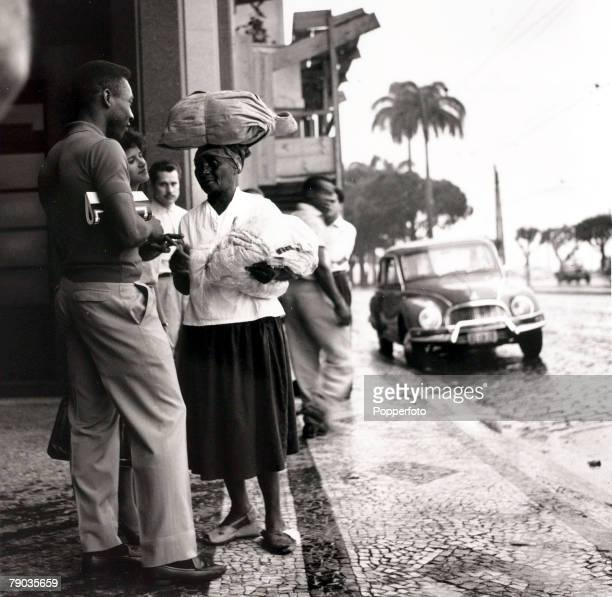 Sport Football circa 1958 Brazilian star Pele chatting with a local woman carrying provisions on her head Pele was perhaps the most famous footballer...