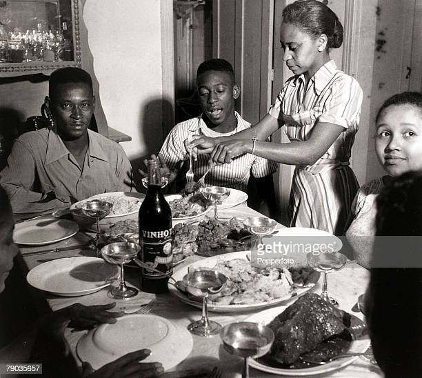 Sport Football circa 1958 Brazil's young star Pele at a family meal his father Dondinho as his mother Dona Celeste serves the food Pele was perhaps...
